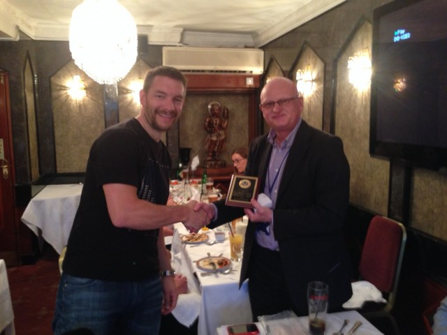 Curry night, May 2014: Stuart Birnie presented with trophy by John Wheatley